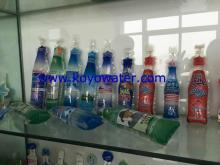 Bottle shaped pouch filing packing machine