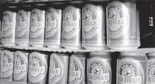 WHITISH CANS OF HEINEKEN BEER FOR SALE