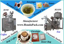 Pyramid tea bag packing machine with outer envelope